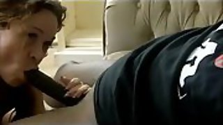 Foxy milf does a giant black boner on the bed