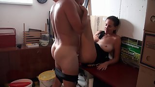 Brunette wife getting fucked by her husband on a desk in their first homemade movie