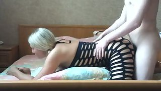 Pig tailed blonde wearing body stocking on all fours doggy fucking