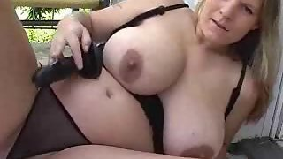 Chubby girl with ample tits plays with a sex fucktoy
