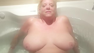 Wife riding hottub jet to her elation