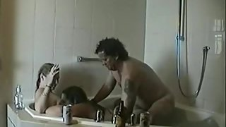 Hot youthful wives enjoy threesome sex with an older man in the bathtub