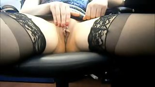 Ginger-haired mature masturbating in the office at home