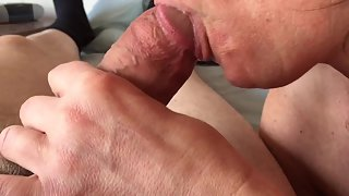 Wife giving her husband blowjob