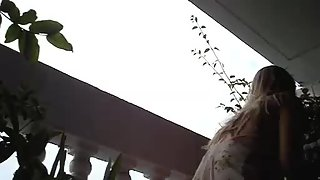 Super luxurious upskirt chick gets filmed at the balcony on the hidden camera