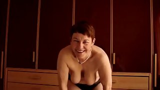 Grit in black lingerie and displaying her genitals