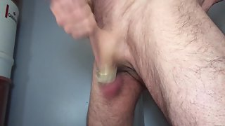 Jerking cock with weighted balls swinging loosely and becoming crimson