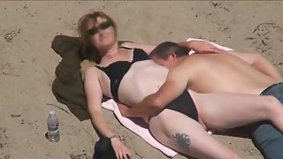 Mature couple sunbathing on beach oral sex and shag in public