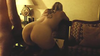 Fucking her from behind while leaned over chair