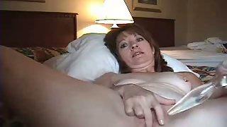 Nice mature lady and her glass dildo masturbating