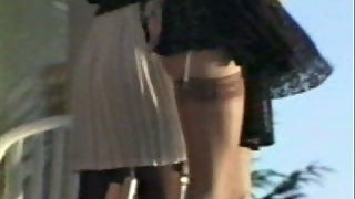 Party girls in skirts blowing in the wind filmed by voyeur