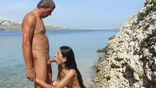 Elder amateurs enjoy having passionate doggie-style hookup at the seaside