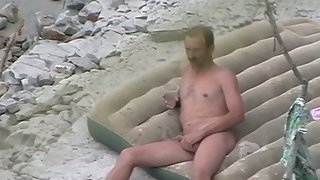 Housewife handjob on a public nudist beach