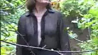 Angela strips in the woods
