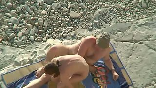 Public sex on the beach while away on holiday in the sun