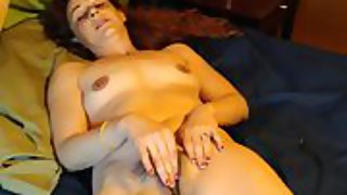 Warm wife masturbating to orgasm for the camera