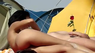 I filmed a lady touching her spouse on a nudist beach rubbing willy