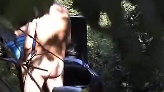 Parked car in the woods at lovers layby peeping tom in bushes filming