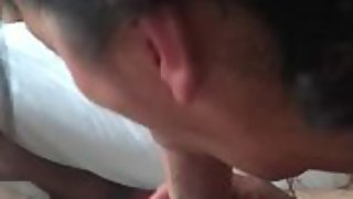 Black haired cougar giving a bj
