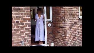 Sarah at the front door wearing a sheer robe