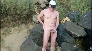 Dude masturbating in his boots with cumshot on the beach