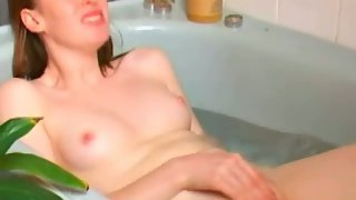 Fabulous ginger-haired rubbing in the tub bringing her luxurious body to orgasm