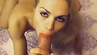 Blonde amateur gargling off a big white cock