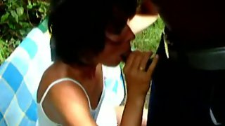 German wife blows her blacklover outdoor