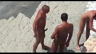 Swinger wife threesome on a nudist beach
