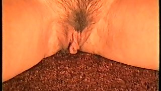 Yvonne flashes you her fur covered honeypot close up as she fingers it