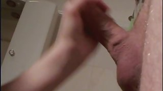 Fabulous petite wife jerking her husband off while he's standing in the bathtub