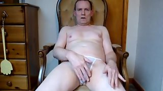 Sitting down on a chair in my briefs and opening up my legs to show off my jizz-shotgun
