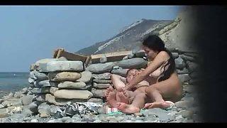 Nudists caught fucking on the beach