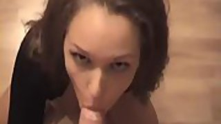 Dark haired goddess pleasuring a brilliant dick with cumshot