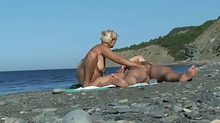 Chesty blonde gives an epic blowjob at the beach