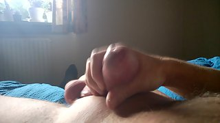 Having a fine rock hard wank with cum