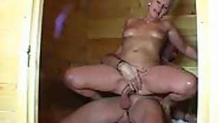German wife gets fucked by her spouse in sauna