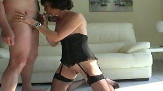 Amateur milf in ebony corset giving head