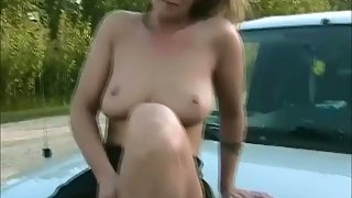 Horny milf jerking outdoors in the car with a electro-hitachi