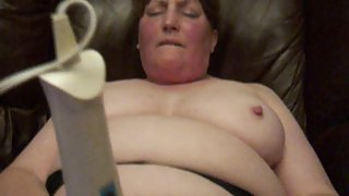 Redhead milf using wand on her couch at home