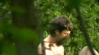Voyeur sex-tape shot outdoors filming young couple in undergrowth porking
