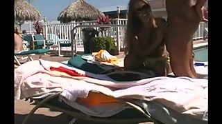 Young platinum-blonde sucks and romps at the pool while being watched by onlookers