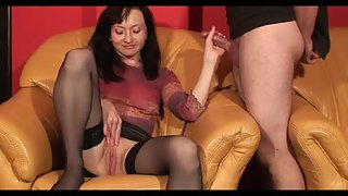 Mature doll gives a sensitive hand-job to a horny guy
