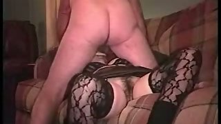 Wife garters and stockings sex on the sofa