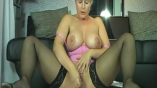 Pretty mature woman with gigantic tits squirts while masturbating