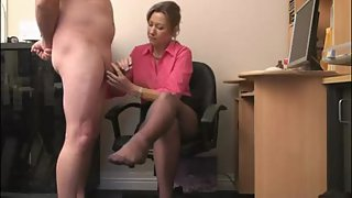 Steaming mature secretary delivers an amazing handjob